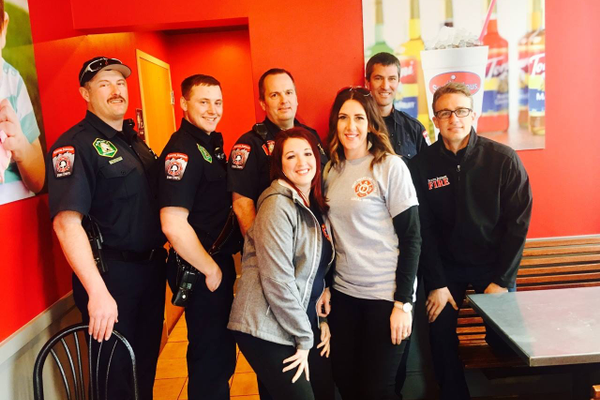 Tony Kirkham and friend Mindy Ruff with members of the South Jordan Fire Department (Toni Kirkham)
