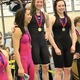 Junior Bella White (center), winner of the 100-yard butterfly, laughs with her teammate, sophomore Nicole Strong (left), who finished third in the same event at the 4A state swim meet. (Travis Barton/City Journals)