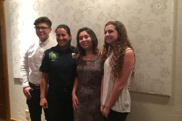 Emma Weatherhead with of the Sandy Fire Department poses with her three mentees. (Rubina Halwani/City Journals)