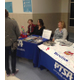 The PTSA at Butler Middle School help answer questions at a school event. (Butler Middle School Facebook)