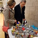 Mayor Carmen Freeman and his wife, Madeline Freeman, look at the donations youth council members collected at their food drive dance. (Herriman City)