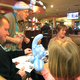 "Brinlee Sundquist, 5, stares at the cat balloon Sherman ""Reed"" Lindholm shaped for her at the Taylorsville Applebee's. (Tori La Rue/City Journals)"