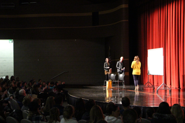 Whitney Berger of The King's English Bookshop introduces author Veronica Roth and Sarah Enni at Granger High School. (April Hendriksen/Tri-Color Times)