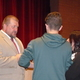 New Murray High School Head Football Coach Todd Thompson speaks with athletes and parents. (Carl Fauver/City Journals)