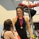 Senior India Phillips shakes hands with her competitor after being awarded the third-place medal for the 500-yard freestyle at the 4A state championship. (Travis Barton/City Journals)