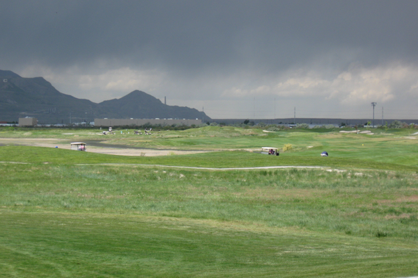 Storm clouds gather over the Stonebridge Golf Course in May 2016. Golf courses raised rates 20 percent for senior players and for range ball buckets. (Travis Barton/City Journals)