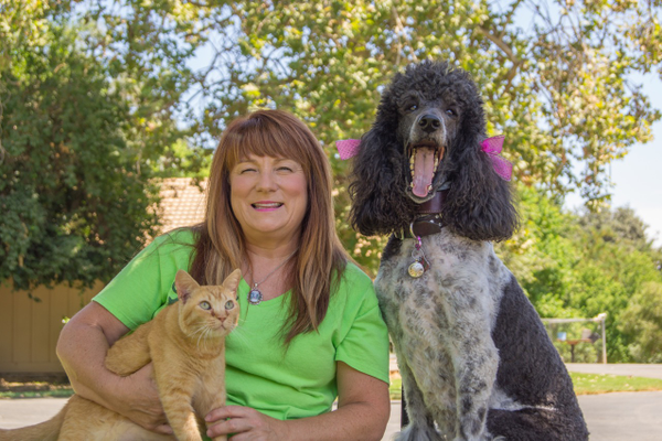 Tammy Barker, The Cat House's Assistant Shelter Director, and her sweet pets.