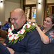 Lautaha is introduced as the newest Cottonwood Heights Police Department officer. His wife drapes a ceremonial lei around him after she pins on his badge.(Dan Metcalf/Cottonwood Heights)