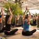 Amanda Jones guides through each pose while attendees listen to the sound of tropical birds and waterfalls. (Keyra Kristoffersen/City Journals)