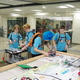 Bionic Porcupines 2.0 First Lego League robotics team practices at the state First Lego League robotics tournament before learning they won the Innovative Solution Award. (Julie Slama/City Journals)