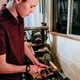 Peyton Williams constructs a wooden pen for his business. The Herriman High School junior was named a regional Gold Key winner in the Scholastic Art and Writing Awards for the memoir he wrote that's partially about pen making. (Peyton Williams)