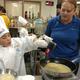 Ricardo Gonzalez cooks his healthy dish at the Granite Education Center Café. (Jet Burnham/City Journals)
