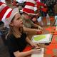 First-graders Ember Goode and Keenan Klaus participate in literacy activities. (Jet Burnham/City Journals)