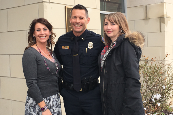 Tori Thacker, Lt. Travis Rees and Ciji Sampson pose for a picture after the unveiling of the justice center's new name. The building was named after West Jordan fallen officer Thomas M. Rees, Thacker and Rees' father and Sampson's step-father. (Tori La Rue/City Journals)
