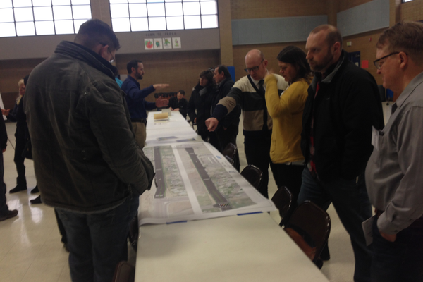 UDOT officials explained construction plans using a scale rendering at a public open house on Feb. 23. (Natalie Conforto/City Journals)