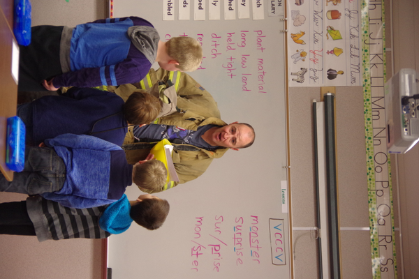 West Valley City paramedic and firefighter Corby Carter talks with third-graders about his career during East Midvale Elementary's Career Day. (Julie Slama/City Journals)