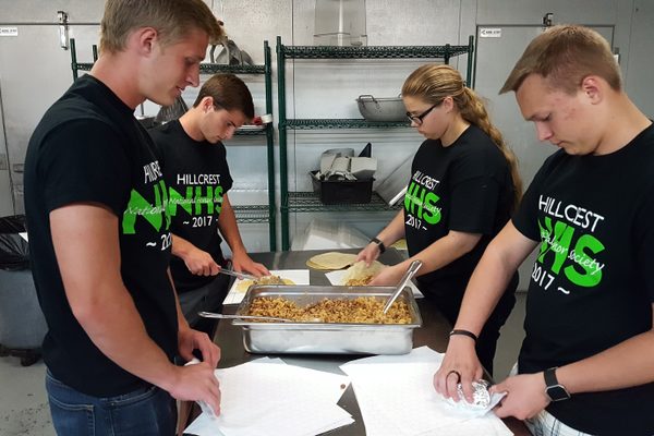 Hillcrest High School's National Honor Society members help wrap burritos that they deliver to the homeless while volunteering with the Burrito Project. (Michelle Hawkins/Hillcrest High School)