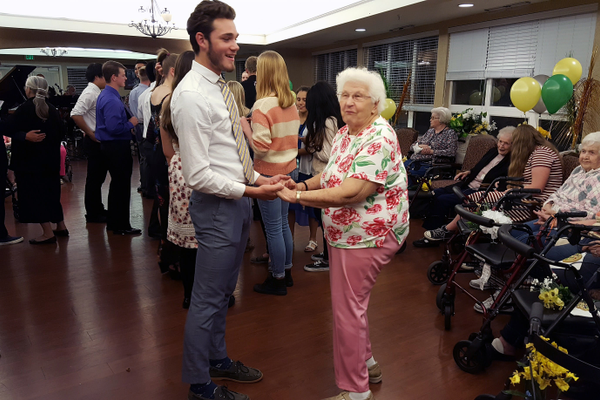 Hillcrest High School's National Honor Society members dance with seniors during Canyon Creek Senior Living's homecoming the high-schoolers planned and organized. (Michelle Hawkins/Hillcrest High School)