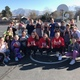 Pulley's Students flash the U outside on the playground after doing cardio drills. (Teacher/Amber Pulley)
