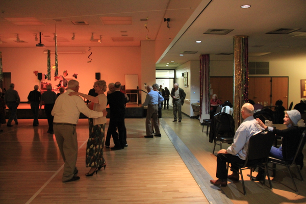 Karl Tinggaard (far middle, in blue) enters the dance floor with a partner at the Murray Heritage Senior Center weekly dance.