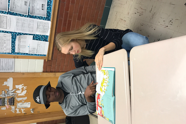 Anna McConkie helps Asumani Wilonja from Tanzania with his reading. (Elaine Toronto/ESL teacher).