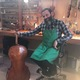"John ""JP"" Lucas has been building violins since he was 13. (Natalie Mollinet/City Journals). Cellist 03: Some of the instruments Lucas is working on going off to musicians around the world. (Natalie Mollinet\City Journals)."