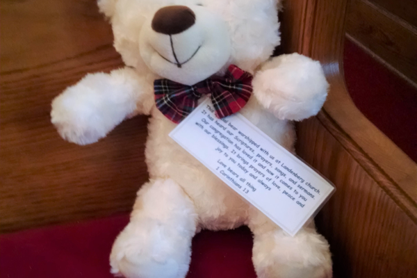One of the teddy bears that sits in the church during services, then is given away. They wear tags that read, 'This special bear worshipped with us at Landenberg church. It has heard our Scriptures, prayers, songs and sermons. Our congregation has loved it and now it comes to you with our blessings. It brings prayers of love, peace and joy to you today and always.' (Photo by Natalie Smith)
