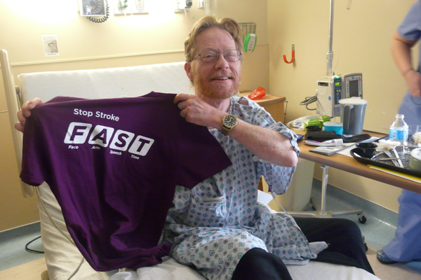 "A patient displaying the Passavant Hospital Foundation ""FAST"" t-shirt"
