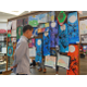 Third-grader and second place winner, Ziyang Tian looks over artwork from fellow students. (Keyra Kristoffersen/City Journals)