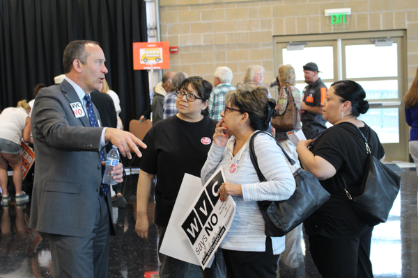 "City Manager Wayne Pyle speaks with residents at an open house on March 21 at the Utah Cultural Celebration Center. Pyle said the city would fight a resource center with ""whatever means they have at their disposal."" (Travis Barton/City Journals)"