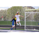 Freshman Trevor Dillon challenges the keeper for the ball during the Chargers' contest against Orem. (Travis Barton/City Journals
