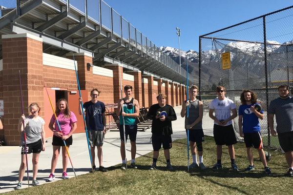 Brighton throwers gather for a photo with their equipment before their throw trials. Left to right: Alexander Royzman, Hailee Briscoe, Katie Shepherd, Jarren Brown, Jacob Nobis, Eli Hansen, Riley Ballard, NiIcholas Newell, Ayden Anderson and Taemour Djahanbani. (Koster Kennard/ City Journals)