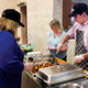 Diane Moretz Joan Foreman and Ryan Forbeck serve dinner at the first Trinity United Methodist Church free meal on April 4 2017 in the churchs fellowship hall