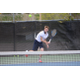 Junior Ryan Boddington, graduating early next year to play tennis at Idaho State, unleashes a serve against Olympus. (Travis Barton/City Journals)