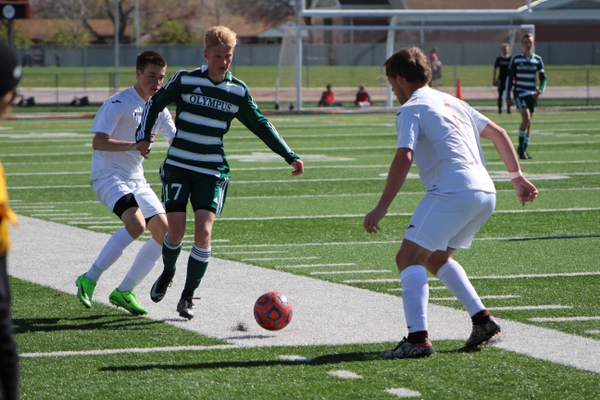Senior Abe Gubler takes on a Murray defender in April. (Travis Barton/City Journals)