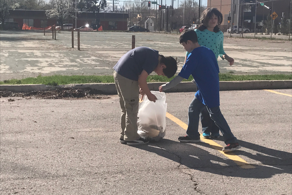 Some kids had the job of holding the trash bags and thewhile others were to pickpicked up the garbage around them. (Natalie Mollinet/\City Journals).