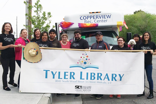 Staff members of the Ruth Vine Tyler Library hold a banner during the Cinco de Mayo parade a year ago. (Ruth Vine Tyler Library)