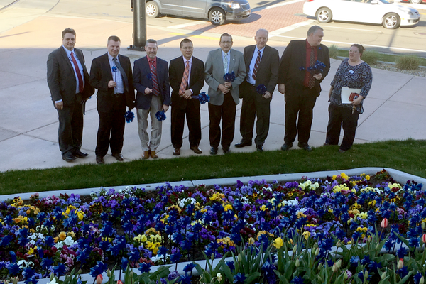 Elected officials and leaders of the Family Support Center planted pinwheels in front of City Hall as West Valley City proclaimed April Child Abuse Prevention month to spread awareness on the problem. (Travis Barton/City Journals)