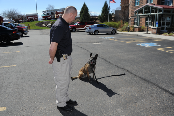 West Jordan K-9 Officer Gregory Gray stands by his partner Police Service Dog, Odin, in front of West Jordan Fire Station 53 where paramedics and emergency medical technicians were trained in late-March on how to save service dogs in. (Reed Scharman/West Jordan Fire Department)