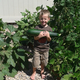 Elijah Oler shows what a garden can look like with healthy soil. (Sarah Oler)