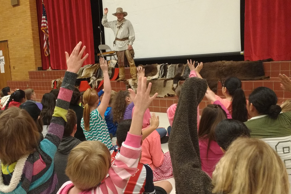 Mountain Man Scott Sorensen tests fourth-graders on their knowledge of Utah trappers and traders. (Jet Burnham/City Journals)