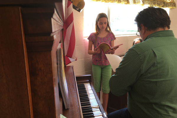 "Eliza Gabbitas, 10, rehearses a solo part from ""Seussical the Musical Jr."" with music director Steven Broschinsky. (Tori La Rue/City Journals)"