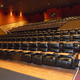 All 14 Regal Cinema auditoriums feature oversized recliner chairs with lap tables for food. (Carl Fauver/City Journals)