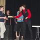 Salt Lake Valley Science and Engineering Fair award presenter Morgan Barron presents American Preparatory Academy's Dylan Bolman with a special award from the Leonardo. (Julie Slama/City Journals)