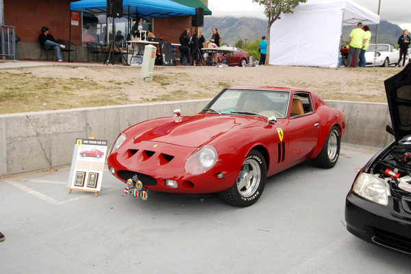 A 1962 Ferrari poses in front of DJ Miss Mariko's booth. (Keyra Kristoffersen/City Journals)