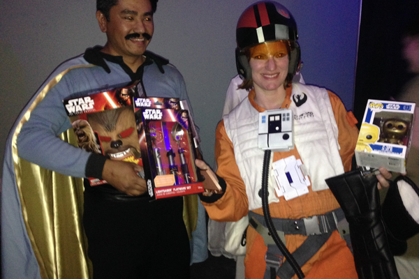 Contest winners Gary and Amanda Lizaso scored Star Wars toys as their prizes. (Natalie Conforto/City Journals)
