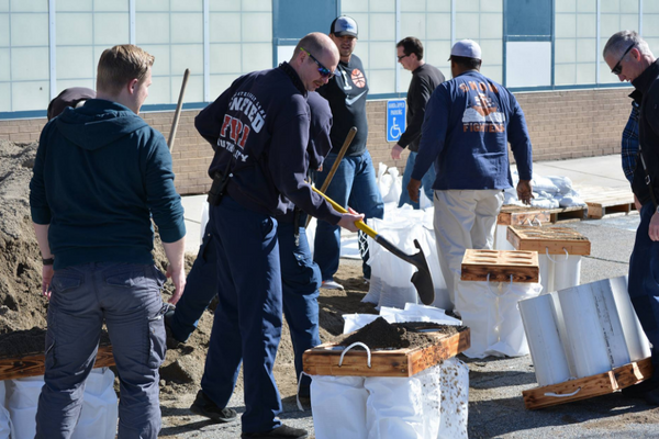 Volunteers fill sandbags during the Great ShakeOut in preparation for flooding within the city. (Dan Metcalf Jr./Cottonwood Heights City)