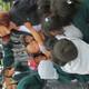Ecuadorian children hug Cherie Summerhays, a Murray Rotarian. (Jerry Summerhays/Resident)