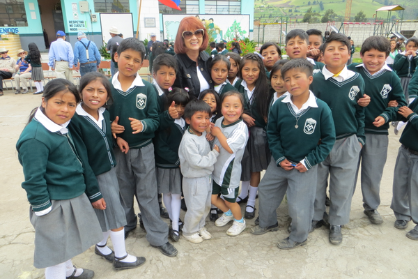 Cherie Summerhays of the Murray Rotary Club with children of Quito. (Jerry Summerhays/Resident)