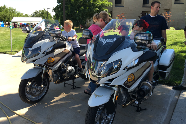Kids sit on highway patrol motorcycles at the 2016 Family Safety Fair. (Utah Department of Public Safety)